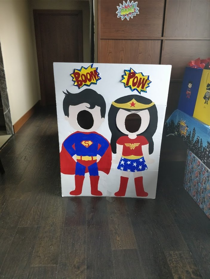 superhero party ideas face in a hole diy board