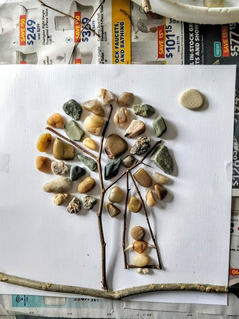 pebble art tree with pebbles and twigs with glue