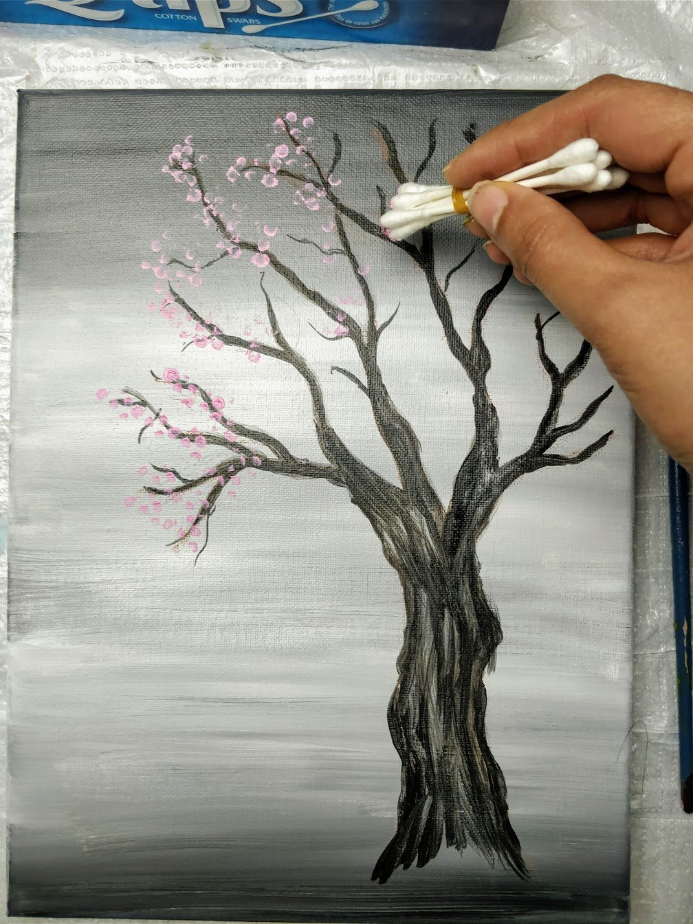 painting a cherry blossom tree with cotton swab