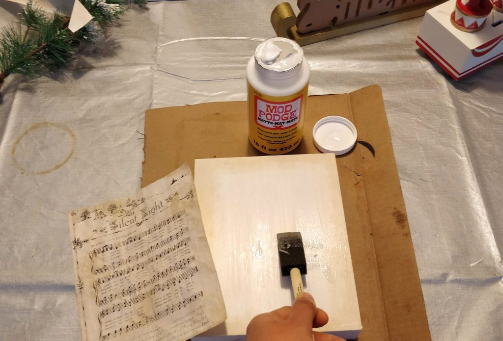 how to mod podge aged paper