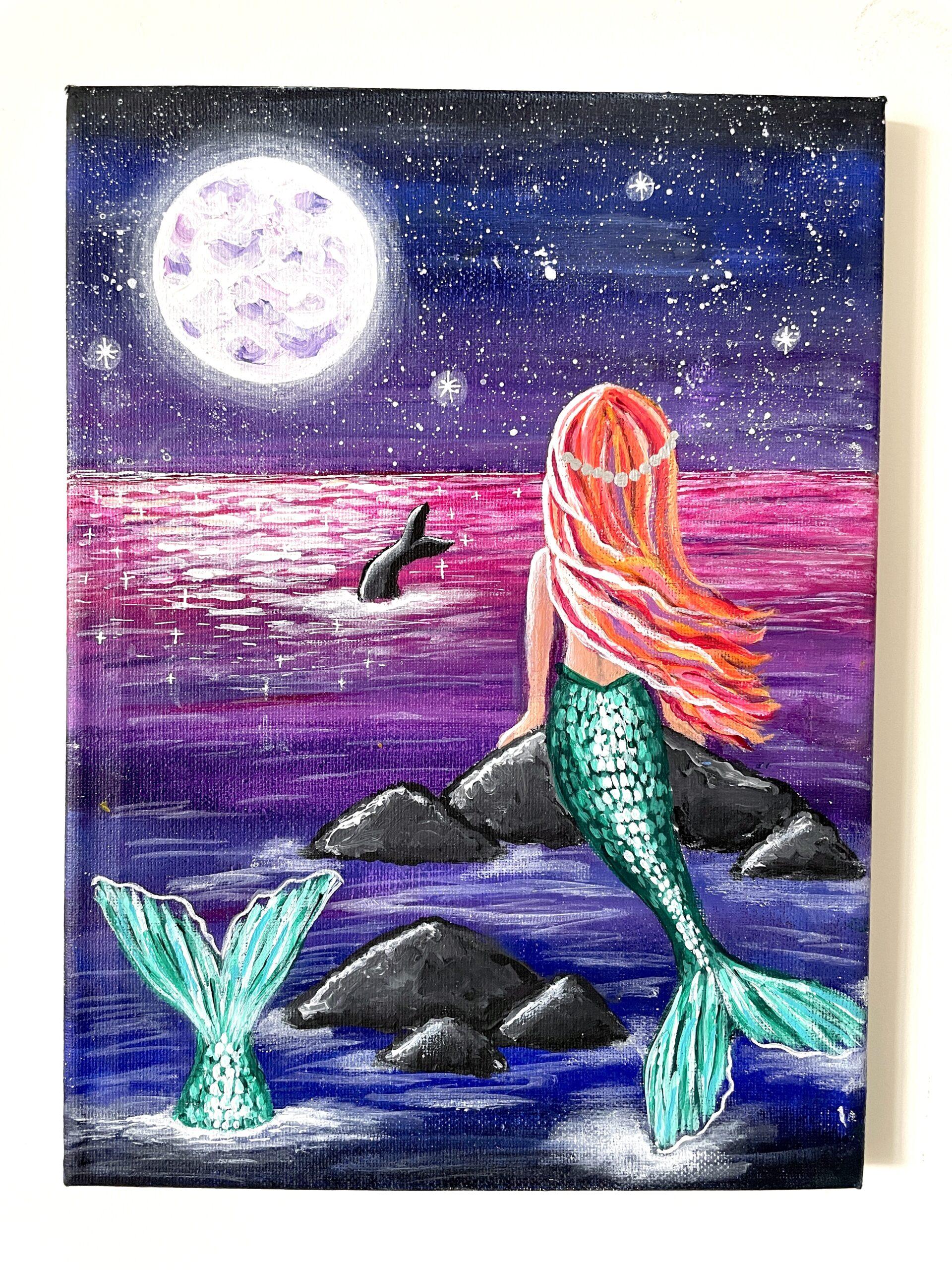 paint a mermaid sitting on rock